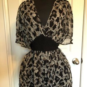 Black and white top/dress with a sheer overlay.